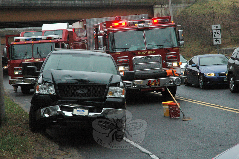 Police report a three-vehicle chain-reaction accident about 9:30 am on March 21 on the section of Berkshire Road lying between its intersections with Wasserman Way and Toddy Hill Road. Motorist Susann Varano, 43, of Bridgewater, who was driving a 2002 Cadillac Escalade southward on Berkshire Road, stopped for traffic conditions, after which southbound motorist Ceylan Eren, 22, of Danbury, who was driving a 2002 Jeep Grand Cherokee SUV, stopped behind the Cadillac. Southbound motorist Matthew Plungis, 27, of Bethlehem, who was driving a 2005 Ford F-150 pickup truck, then struck the rear end of the Jeep, pushing the Jeep into the rear end of the Cadillac. There were no injuries. Sandy Hook  firefighters responded to the accident. Police  issued Plungis an infraction for following too closely.—Bee Photo, Gorosko