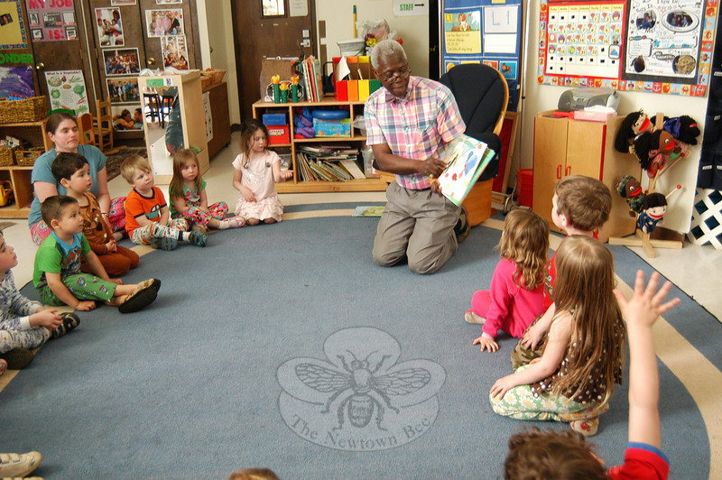 Former Connecticut Education Commissioner George Coleman read to students at the Children's Adventure Center on Thursday, March 22, for the Books, Pajamas, and Pizza family night event.   (Hallabeck photo)