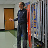 Interact Club advisor Bruce Moulthrop stands next to the rack containing lengths of precut duct tape, meant to expedite the process of selling pieces of tape for a dollar to stick teacher Don Ramsey to the wall. Stuck For A Buck was an Interact Club promotion.  (Crevier photo)