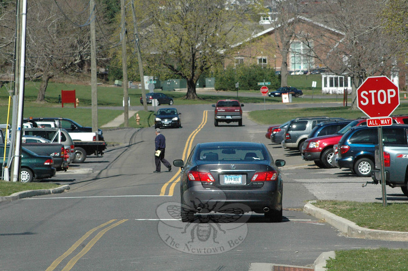 "A pedestrian walks across the Fairfield Hills street that passes between Newtown Municipal Center and Kent House. The police department will perform a traffic study at the town-owned Fairfield Hills complex to learn what ""traffic calming"" measures can be taken there to improve traffic and pedestrian safety.   (Gorosko photo)"