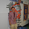 "NMS eighth grader Omar Rodriguez is all smiles, Friday, March 30, after adding his length of duct tape to those already adhering teacher Don Ramsey to the cafeteria wall. Mr Ramsey was ""Stuck For A Buck"" as part of the Pennies For Patients Leukemia and Lymphoma Society fundraiser at the middle school last month.  (Crevier photo)"