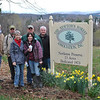 Front row, Mary Gaudet-Wilson and Michelle McLeod; back row, Ray Ormsbee, NFA President Bob Eckenrode, state forester Larry Rousseau, and Dan Dalton gather at Nettleton Preserve Monday morning, April 2. In the background is the iconic view of Newtown, now somewhat obscured by tree growth. Improving that view is an integral part of Newtown Forest Association's property management plan.  (Crevier photo)
