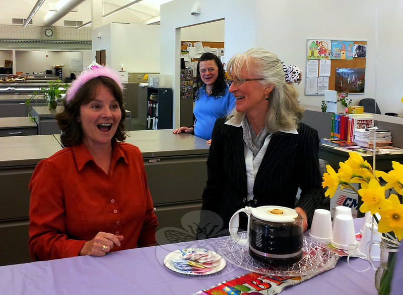 Newtown Health District Director Donna Culbert looks happily surprised, although she was already apprised of an office birthday party being held in her honor at the Newtown Municipal Center March 21. Ms Culbert is pictured among the well-wishers who attended, including district Administrative Assistant Maureen Shaedler and Cathy Monckton, a town Code Enforcement Officer.  (Voket photo)