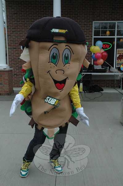 On Saturday, March 31, Plaza South at 266-276 South Main Street (Route 25) held its debut Block Party to promote businesses at the shopping center, and the entire area was alive with activity. Among the participants was Subman, the mascot for the Subway sandwich shop at Plaza South, who danced outside the store.  (Gorosko photo)