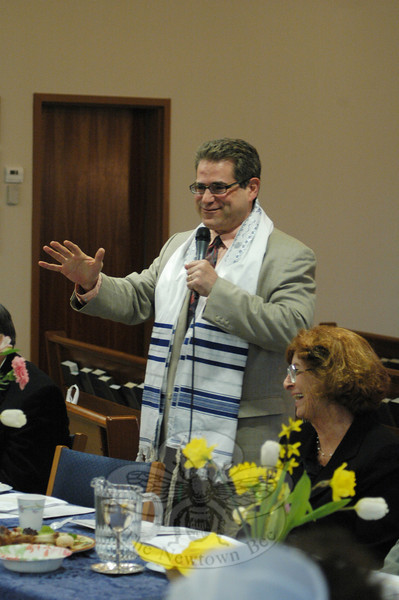Rabbi Praver read passages from the Haggadah at the Newtown Interfaith Passover Seder at Congregation Adath Israel.  (Gorosko photo)