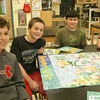 "From left, Michael Arther, Robert DiSibio, Alex Wong, and Matthew Blanco set up ""Business Game"" to play on Monday, April 2, during the final class for Reed Intermediate School's Junior Achievement program this school year.  (Hallabeck photo)"