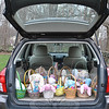 Easter baskets fill a car trunk Thursday morning, March 29, ready for delivery to area social service organizations. The Easter basket project is an annual event for Women Involved in Newtown (WIN) and benefits needy children in the area.   (Crevier photo)