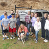 Animal Control Officer Carolee Mason is in front of the canine control sign with Misty, a pet up for adoption. From left is St Rose School faculty advisor Beth Salaris with students Evan Doering, Anna Brubaker, Gavin Connor, Charlie Assetta , Jesse Spina, Helena Sabo, Calista Connor, Muriel Deccache, Stella Sabo, Kristen Cirone, and Lauren Adams.   (Bobowick photo)