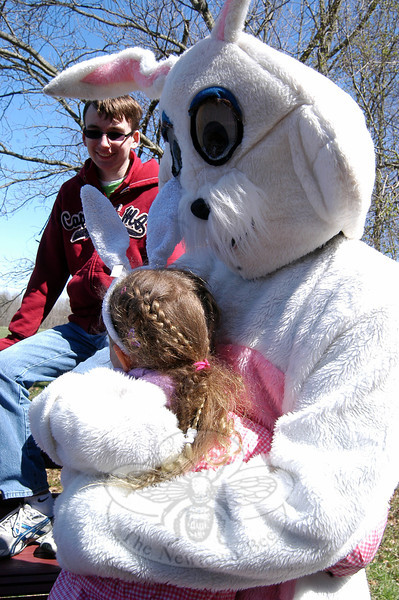 "Anna Peck received a hug from the Easter Bunny on Friday, April 6, during the first day of Bunny Watch 2012, a fundraiser to help send two Newtown Odyssey of the Mind teams to the national level of the competition. High school Odyssey of the Mind team member Zach Weiland looks on.   (Hallabeck photo)<br /> <br /> PLEASE NOTE: Additional photos from the 2012 Bunny Watch Hayride were used for a slideshow, and have been filed in a separate photo album. Those photos can be found here: <a href=""http://photos.newtownbee.com/Events/This-Years-Bunny-Watch-Drew-A/22438766_g7zw24#!i=1793915895&k=8b2xDpq"">http://photos.newtownbee.com/Events/This-Years-Bunny-Watch-Drew-A/22438766_g7zw24#!i=1793915895&k=8b2xDpq</a>"