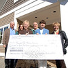 Making their donation official, Canine Advocates of Newtown (CAN) board members gath-ered on April 3 to present seven years' worth of funds raised to benefit a new animal control facility — more than $235,000 — to the town. From left are Frank McCloskey, Trish Wootton, First Selectman Pat Llodra, Phil Vail, CAN President Virginia Jess, and Adria Henderson. The group is standing at the new facility at the end of Old Farm Road Extension off Trades Lane.   (Bobowick photo)