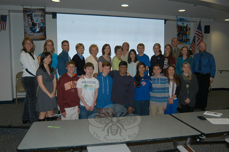 Some of the delegation members scheduled to travel to China representing Newtown this week who met on Monday, April 9, in the Newtown High School Lecture Hall for one last debriefing.   (Hallabeck photo)