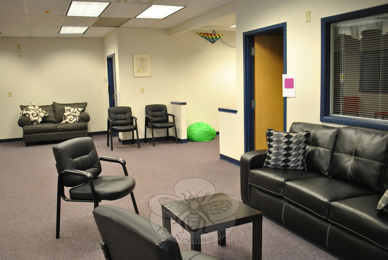 Two new couches and six chairs populate the waiting room at the new NYFS location on Berkshire Road, thanks to a generous $800 gift certificate from Bob's Discount Furniture in Danbury.   (Crevier photo)