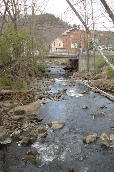From a narrow footbridge that spans the river in Sandy Hook Center residents can stand roughly 15 above the Pootatuck River and listen to water rushing over stones.   (Bobowick photo)