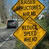 Road signs have been posted along Queen Street warning motorists that speed tables have been installed there and advising them to reduce their speed.  (Gorosko photo)