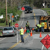 """Town Public Works Department workers installed a temporary broad speed bump, known as a """"speed table,"""" across Queen Street, just south of its intersection with Borough Lane, on Tuesday.   (Gorosko photo)"""
