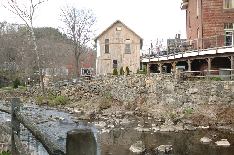 Old retail and industrial structures now used as The Stone River Grille, right, and demitasse coffeehouse, center, sit right on the Pootatuck.  (Bobowick photo)
