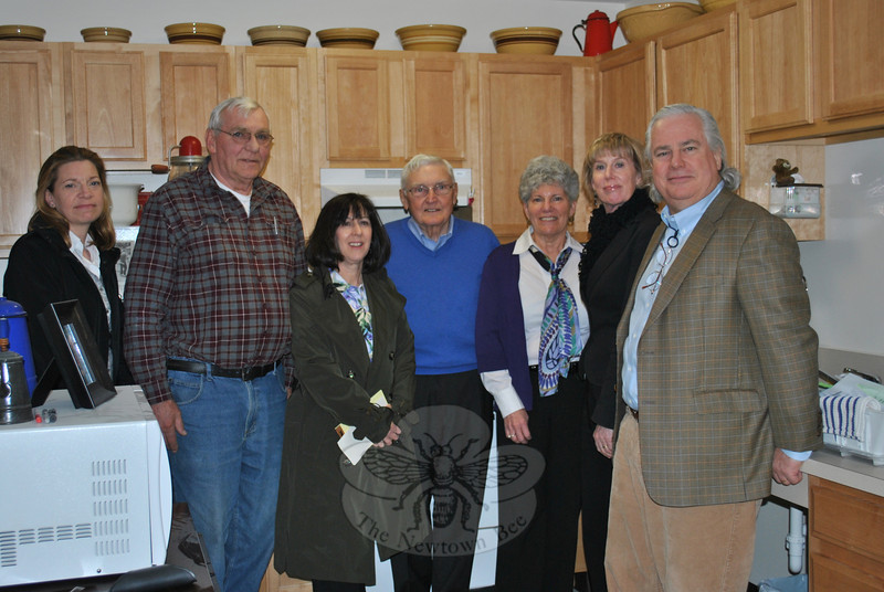 From left, architect Jennifer Duckworth, maintenance supervisor Art Monsanto, Shelly Pille from the state Department of Economic and Community Development, Bernie Curran, president of the Newtown Housing for the Elderly, Nunnawauk Executive Director Linda Manganaro, Newtown Economic and Community Development Director Elizabeth Stocker, and architect Hugh Sullivan gather in one of the apartment kitchens recently refitted to accommodate special needs.   (Crevier photo)