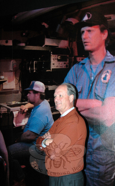 Famed oceanographic explorer Dr Robert Ballard positions himself in front of an image taken in 1985 during the oceanographic expedition that first located and mapped the sunken Titanic. Mystic Aquarium has opened a new permanent exhibition that honors the famed ocean liner and her final resting place. .   (Voket photo)