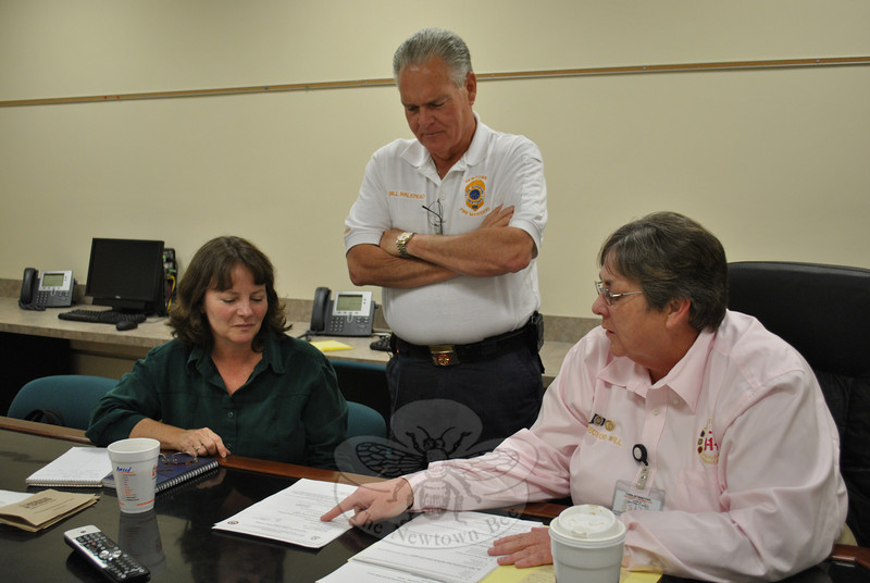 From left, District Health Director Donna Culbert, Fire Marshal Bill Halstead, and Director of Emergency Communications Center Maureen Will discuss the upcoming orientation meeting to generate interest among residents for a Newtown Community Emergency Response Team program.   (Crevier photo)
