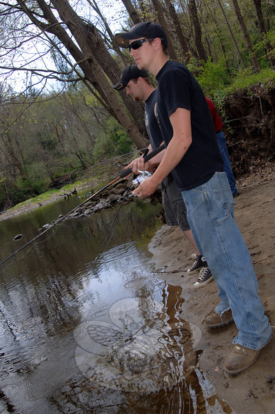Kyle and Andrew Degenhardt cast their lines into the shallows in the Pootatuck River Saturday, April 21, on the opening day of fishing season.   (Bobowick photo)