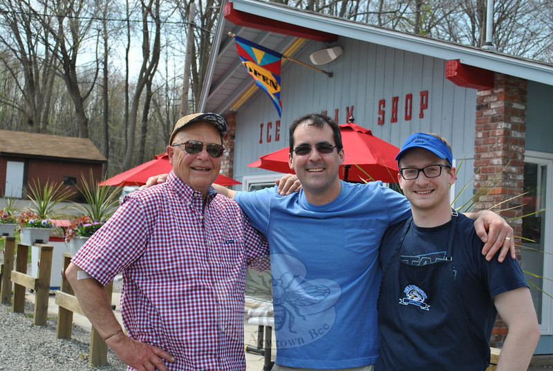 From left, Charlie White, Mike Coppola, and Jason Rabatin pause for a moment of camaraderie in front of Holy Cow Ice Cream Shop. Mr White is the original owner of the Church Hill Road Ice Cream Shop; Mr Coppola and Mr Rabatin took over the business three years ago.   (Crevier photo)