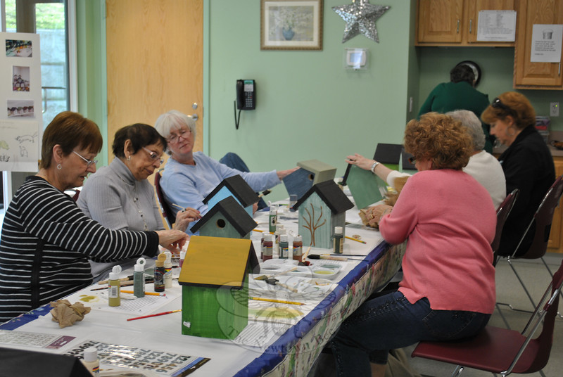 Members of the Newtown Senior Center enjoyed a morning of painting birdhouses, an intergenerational project sponsored by NHS junior Rachel DiVanno.	  (Crevier photo)
