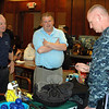 From left, Rick Spring and John Stella from Northeast Diving Services chat with Navy Reserve diver Jim Denison, who is stationed at Newport, R.I., during the midday break at the second annual Diving Medicine Conference at Danbury Hospital. Author Richard Hyman was also on hand, meeting attendees and signing copies of his book, Frogmen.   (Voket photo)