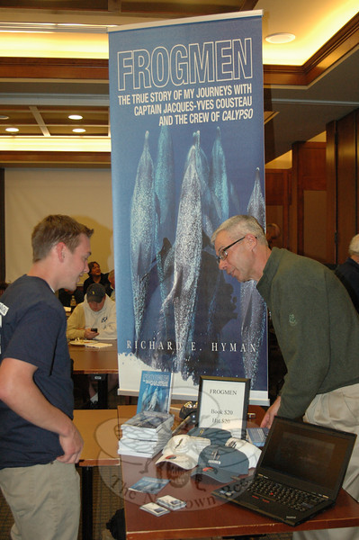 Author Richard Hyman was also on hand during the Second Annual Diving Medicine Conference at Danbury Hospital, meeting attendees and signing copies of his book, Frogmen.   (Voket photo)