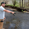 Gabe Blais tried his luck from the Pootatuck River banks in Sandy Hook Center on Saturday, April 21.   (Bobowick photo)