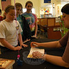 Easton author Elise Broach, right, signed copies of her books for students at Reed Intermediate School after speaking to the students.  (Hallabeck photo)