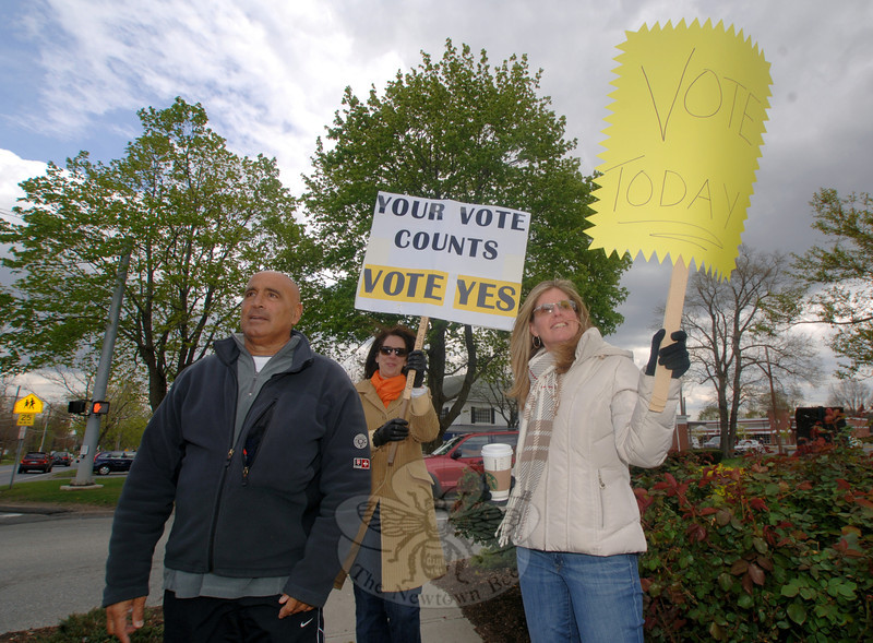 Board of Education members John Vouros, left, and Laura Roche, and Legislative Council member Kathy Fetchick, right, were at the corner of Church Hill Road and Queen Street on Tuesday afternoon, reminding residents to get to the polls before referendum voting closed at 8 pm.   (Bobowick photo)