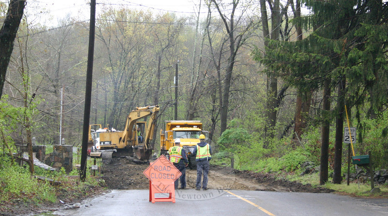 "A portion of Hanover Road was closed as of Monday, April 23, between house numbers 51 and 62. This is a 1,300-foot stretch of road that runs from just south of Papoose Hill Road to north of Blakeslee Drive's intersection with Hanover. Public Works crews are working with Nagy Bros to lower the center of the road about three feet. ""We are lowering the road in the middle, to widen and stabilize it,"" Public Works Director Fred Hurley said on April 20. ""Bottom line, this will make the road safer."" In addition, old wood and cable guardrails will be replaced with metal guardrailing along this stretch. Only local traffic (homeowners) will be allowed into the construction area while the project is ongoing. Public Works Crew Chief Anthony Capozziello and Assistant Town Engineer David Bratz, co-supervisors on the project, hope to have everything finished within three weeks. Detours are posted.                  —Bee Photo, Hicks"