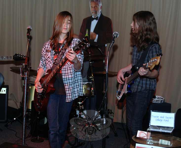 "Teen band Stretch will return to headline during happy hour at The One-Eyed Pig Bar & Restaurant, at 71 South Main Street, on Friday, May 4. Featuring Trevor Legeret, left, and Devon Covert, two 13-year-old musicians on guitar, bass, and vocals, with back-up from Newtown-based guitar instructor Joe Proc and Trevor's father Dave Legeret, Stretch will perform during the bar's weekly Friday acoustic happy hour, from 5 to 8 pm. ""The thing about these two is they have the attitude and the talent. They sing, they play. They're little rock stars,"" Mr Proc said prior to their debut in February, when this photo was shot. The One-Eyed Pig welcomes families for dinner, drink, and entertainment. Guests under the age of 21 must be accompanied by a parent or legal guardian. Acoustic jams run from 5 to 8 pm on Fridays.   (Bobowick photo)"