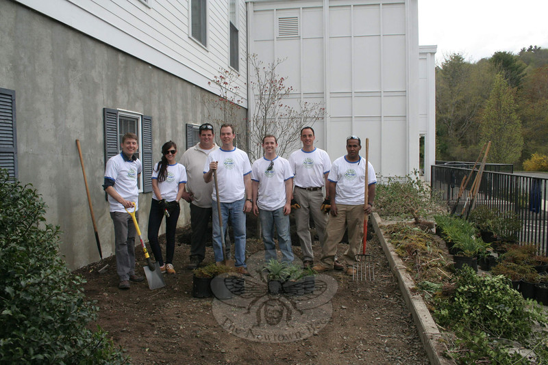 "Employees of Wilton-based The LaurelRock Company spent Friday, April 20, in Newtown, where they worked on a pair of beautification projects for its annual Planet Day of Service contribution. One crew was sent to Fairfield Hills, where members installed a much-needed irrigation system for The Victory Garden, while a second crew spent four hours at Newtown Congregational Church. From left is designer Allan Broadbent, administrative team member Ashley Cipollone, garden manager Nick Moraske, designer Dan Blackman, production manager Sean Ragan, LaurelRock President Burt DeMarche, and field supervisor Wilton Franco. This team spent their afternoon refreshing the gardens of the West Street church. The area to the immediate north of the church building, where the group was standing for this photo, was filled with good soil to help improve the grade as well as anchor the plant-ings, and then peonies, ""Bridal veil"" astilbe, black-eyed Susans, vinca and snow mount spirea were all planted. ""For a lot of people who don't always get to go out, this is a fun day for them,"" said Mr DeMarche, whose family lives in Newtown. The Planet Day of Service is an annual national lawn and landscape industry event that encourages local professionals to organize volunteer projects in their own communities to beautify the grounds of schools, parks, playgrounds, senior centers, shelters and anywhere people enjoy green spaces.   (Hicks photo)"