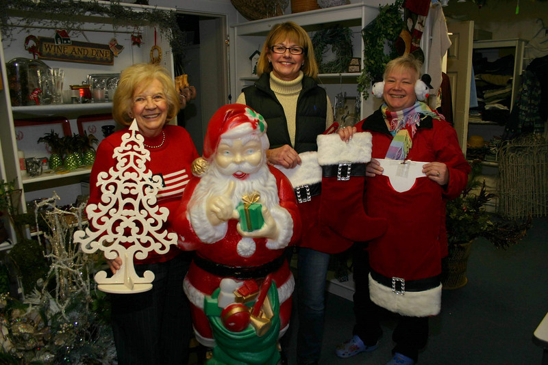 It's been looking like Christmas inside the VNA Thrift Shop at Edmond Town Hall for a few weeks now, and the members of the local Visiting Nurse Association chapter hope residents will take advantage of great deals offered by the shop. Mae Schmidle, Mary Tietjen, and Anna Wiedemann, from left, were in the shop, the entrance of which can be found from the lower rear parking lot at 45 Main Street, recently checking on the final preparations by fellow VNA members. In addition to its regular hours of Wednesdays from noon to 3 and Saturdays from 9 am until noon, the store will have special Holiday Boutique hours on Sundays, December 5 and 12, from 11 am to 2 pm. In addition to seasonal items, the shop regularly offers clothing, games, books, and other household items.  (Hicks photo)