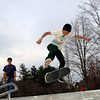 Jesse Dantini, second from right, strikes a pose while he stands with friends who wait their turn to run through the skate park's rails, ramps, full bowl, and stairs.  (Bobowick photo)