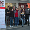 "A National Adoption Month information event held November 14 at demitasse cafe in Sandy Hook was an opportunity for regional Department of Children and Families adoption and foster care staff to socialize with one of Newtown's newest adoptive families. Among those gathering for the event, from left, were Mike Landy, owner of demitasse, Rose, John, and Christine Wheway, DCF staffers Yvette Newtown, Robyn Wood, Kate Coffey, her young son Sean, and Newtown Police Officer Steve Siecienski, who was heading up a ""Stuff-A-Cruiser"" toy drive for local foster families.  (Voket photo)"