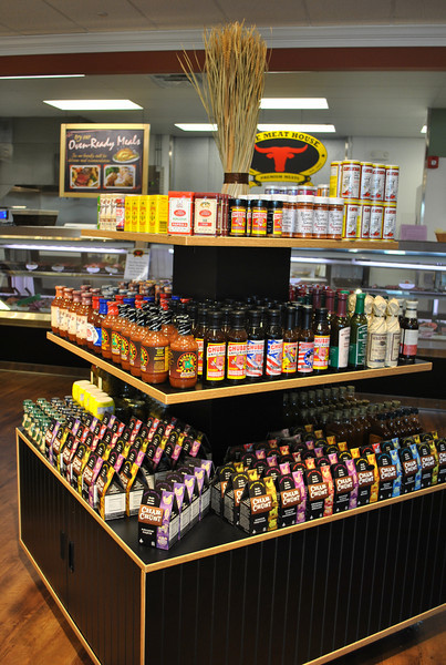 The Meat House, located at Plaza South on South Main Street, opened September 24 and is Newtown's newest market in Newtown's newest shopping plaza. Its name evokes a vision of cleaver-wielding men in white paper hats, working under dim lamps over well-used butcher blocks, but The Meat House is far from that. Receiving equal attention is the line of groceries neatly displayed in kiosks scattered throughout the 3,500 square feet of shopping space. The selection includes specialty and locally produced items that work to create complete meals when combined with the meats sold at The Meat House.  (Crevier photo)