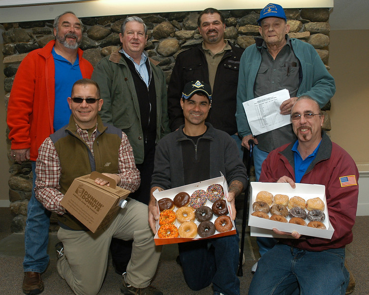 Shown in Nunnawauk Meadows' community building are seven of the Masons who participated in a public service project that delivered hot coffee and fresh donuts as part of Newtown Senior Appreciation Day. Pictured, from left, front row, are E.J. Belmont, Bill Dene, Richard Goessinger; rear row, Ron Eastwood, Richard Hubert, Jozef Prah, and Kenn Williams.  (Gorosko photo)
