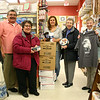 Drug Center owner Donald Bates recently contacted Newtown Woman's Club members about some items he wanted to give to them, in turn for their efforts to bring comfort and joy to the men and women who live at Connecticut's veterans homes. Mr Bates offered some clothing including T-shirts and diabetic socks, toothbrushes, boxes of books and playing cards, and many tins of cookies. From left is Mr Bates; Marion Thompson, chair of veterans and public issues for NWC; Drug Center employee and Mr Bates's daughter, Teri Ann Brunelli; Woman's Club member Mary Antey; and Nancy Kennedy, NWC co-vice president. Appropriately, the donation was given to the women's club on Veterans Day. The items, promised Mrs Thompson, will be divided and delivered to the Veterans Home & Hospital in Rocky Hill and Veterans Center in West Haven.  (Hicks photo)