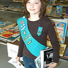Girl Scout Troop 50628 member Gillian Faircloth was the first scout to arrive at the 5th An-nual Book Sale and Coat Drive held Saturday, November 13, at the Newtown United Meth-odist Church's Rauner Hall. The event lasted until 4 pm in the afternoon and proceeds bene-fited the Newtown Girl Scout Service Unit. Girl Scout families donated the books for the event, and books not sold during the sale will be donated to area charities. All coats, hats, gloves, and mittens collected during the day in conjunction with the Newtown United Methodist Church Outreach Committee will be donated to the Interfaith AIDS Ministry, In-terfaith Nursery, and Covenant House.Hallabeck