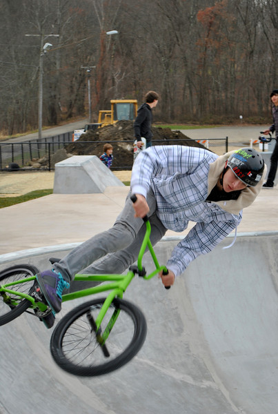 A BMX bicyclist, who identified himself as Adam LZ, turns his bike parallel to the edge of the bowl at the new skate park at Dickinson Park, Saturday, November 20, pleased to find a place to practice his moves in Newtown.  (Crevier photo)
