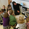 Jennifer Hubbard of The Walker Hill Studio in Sandy Hook visited St Rose of Lima preschool students on Friday, November 12. The studio offers group art classes that focus on a single art master. Each student learns the artist's techniques and creates a work of art for themselves. On Friday the 4- and 5-year-old students learned about Picasso by creating paper cutouts of hands holding colorful flowers.  (Hallabeck photo)
