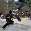 Brandon Capaldo gets some air off of the steps of the Newtown Skate Park early Saturday morning, opening day for the new skateboard, bike, and rollerblading space, while Tim Ciavara records the feat on video.  (Crevier)