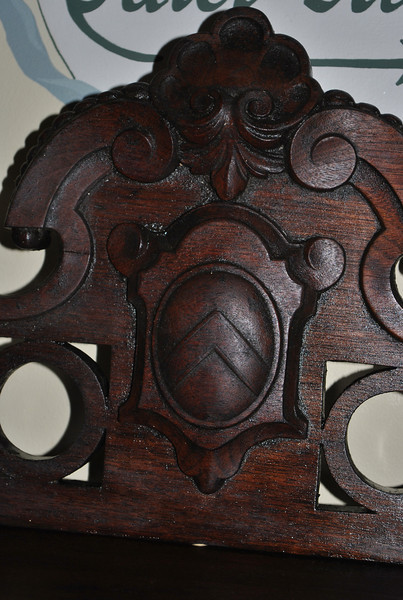While the desk donated last year to the C.H. Booth Library was most likely machine made in a small factory nearly 150 years ago, certain decorative features of the desk, such as this one, were most likely carved by hand.  (Crevier photo)