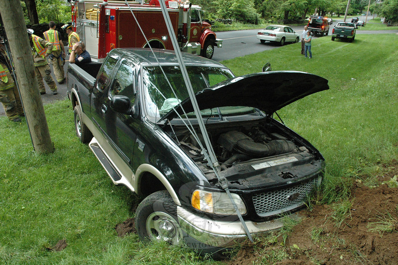 Police report a two-vehicle accident about 4:18 pm on May 22 on Currituck Road, just south of its intersection with Hall Lane. Police said that motorist Stacy Todice, 41, of 55 Sugar Street was driving a 1999 Ford F-150 pickup truck southward on Currituck Road and then drove over the road's center line, colliding with a northbound 1997 Buick Park Avenue se-dan driven by Lori Hubina, 50, of 3 Sunset Hill Road. Both drivers reported pain after the collision, police said. Newtown Volunteer Ambulance Corps members and Newtown Hook & Ladder volunteer firefighters responded to the incident. Police report that they charged Todice with driving under the influence and with failure to drive to the right.   (Gorosko photo)