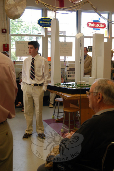 Newtown Middle School student Reed Bryant stands next to his model of the new World Trade Center complex at the start of a dedication ceremony held on Thursday, May 17, when the model and shard of steel found by then-New York Police Department Sergeant Leonard Campanale were given to NMS.   (Hallabeck photo)