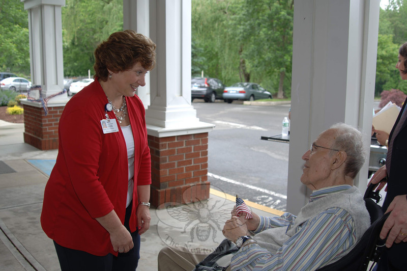 Masonicare Director of Nursing Patti Russell speaks with Jack Rosenthal, a former Newtown First Selectman, during a Memorial Day ceremony at Masonicare.    (Bobowick photo)