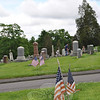 Members of the Newtown VFW Post 308 spread out across the cemeteries in Newtown and Sandy Hook Wednesday morning, May 23, placing nearly 1,000 American Flags on the gravesites of veterans. Every year, the VFW Post 308 purchases flags to mark the graves of veterans of the armed services. The flags remain in place all year long, and are replaced just before Memorial Day each year.   (Crevier photo)