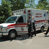 Ambulance and paramedic crew members at the Newtown Volunteer Ambulance Corps garage at 77 Main Street scrambled after receiving an ambulance call midday on Saturday, May 19, during an open house event that was being held at the garage.   (Gorosko photo)